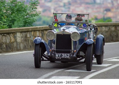 """FLORENCE, ITALY - MAY 19: O.M. Superba along Via Bolognese during the 1000 miles on May 19, 2013 in Florence, Italy """"Mille Miglia"""" is a car race attempted by many celebrities"""