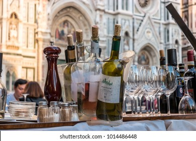 Florence, Italy, May 2017 - Italian Wine with Florence Cathedral of Saint Mary of Flower in background. Florence Duomo (Duomo di Firenze)
