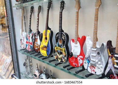 Florence, Italy, May 2019: small multicolored souvenir guitars on display