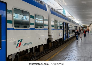 FLORENCE, ITALY - MAY 6, 2016: Trenitalia company train at the Firenze Santa Maria Novella, Florence. Trenitalia is the primary train operator in Italy