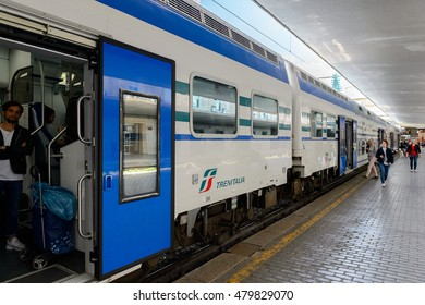 FLORENCE, ITALY - MAY 6, 2016: Trenitalia company train at the Firenze Santa Maria Novella, Florence. Trenitalia is the primary train operator in Italy