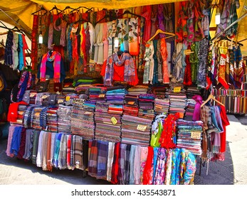 FLORENCE, ITALY - MAY 8, 2014. Selling scarves at the market in Florence - personal and non-cash payment, Italy