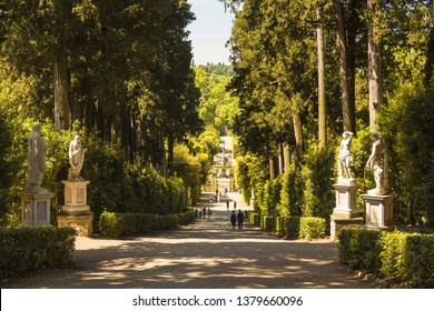 FLORENCE, ITALY - MAY 9, 2014: Park alley with statues in the Boboli gardens. Florence. Italy