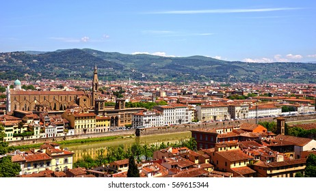 FLORENCE, ITALY, MAY 9, 2014: View of the embankment of the river Arno, the national Central library of Florence, the Basilica of Santa Croce from the observation deck of the Boboli gardens.