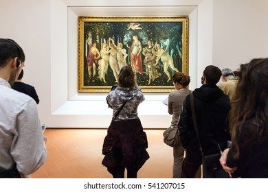 FLORENCE, ITALY - NOVEMBER 5, 2016: people in Botticelli room of Uffizi Gallery. The Uffizi is one of the oldest museums in Europe, its origin refers to 1560, when Vasari designed large palace
