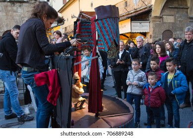FLORENCE, ITALY - OCTOBER 18, 2015: Children watching the performance of a street puppet theater on the Ponte Vecchio bridge