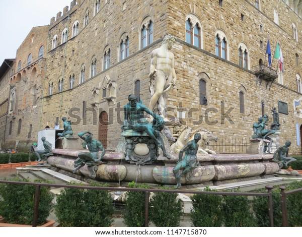 Florence / Italy - October 2012: The fountain of Neptune by Bartolomeo Ammannati, in the Piazza della Signoria, Florence, Italy.