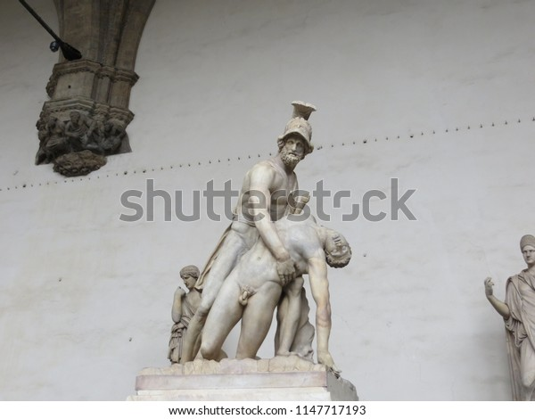Florence / Italy - October 2012: Statue of Menelaus supporting the body of Patroclus, Loggia dei Lanzi, Signoria Square in front of Palazzo Vecchio, Florence (Firenze), Tuscany, Italy.