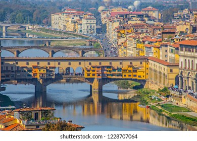 FLORENCE, ITALY - October 2018: Aerial view of bridge  Ponte Vecchio in Florence, old stone bridge, photo taken from Michelangelo Square, Italy
