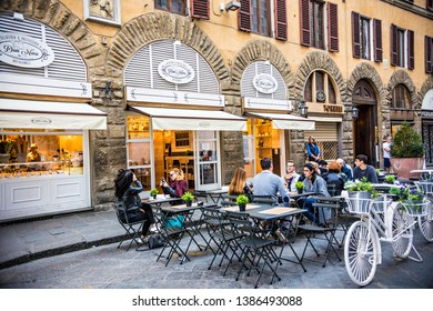 FLORENCE, ITALY - October 2018: People enjoying food at outdoor restaurant close to Duomo Piazza, Florence, Italy
