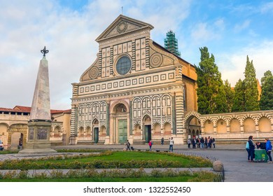 Florence, Italy - October 24, 2018: Facade of the Basilica of Santa Maria Novella on blue sky background and people