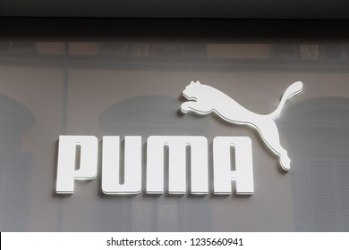 Florence, Italy - OCTOBER 25, 2018: Puma logo on Puma's shop. Puma is a german company that designs and manufactures athletic and casual footwear