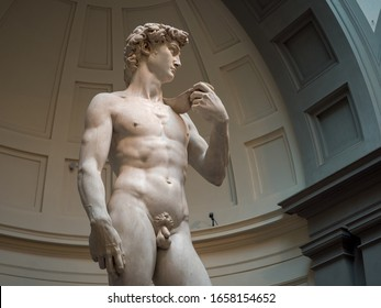 Florence, Italy - October 26, 2019 : David statue is a masterpiece of Renaissance sculpture created in marble between 1501 and 1504 by Michelangelo in Galleria dell'Accademia di Firenze.