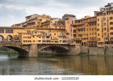 FLORENCE, ITALY - OCTOBER 28, 2018: Beautiful view of the Ponte Vecchio bridge across the Arno River
