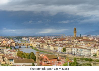 FLORENCE, ITALY - OCTOBER 30, 2018: Panorama of Florence with the Ponte Vecchio, and the Palazzo Vecchio.