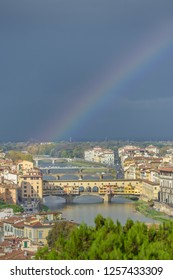 FLORENCE, ITALY - OCTOBER 30, 2018: Storm clouds and a rainbow over the Ponte Vecchio in Florence in Italy.