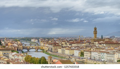 FLORENCE, ITALY - OCTOBER 30, 2018: Panorama of Florence with the Ponte Vecchio, the Palazzo Vecchio, Giotto's Campanile and the Santa Maria del Fiore or Duomo.