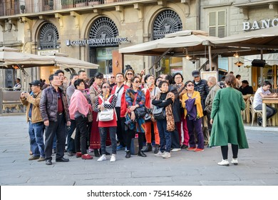 Florence, Italy - October 30th, 2017: Group of middle aged and older Asians on a package tour in Florence, Tuscany, Italy