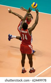 FLORENCE, ITALY - OCTOBER 5: cuban player Raydel Hierrezuelo sets the ball at Volleyball World Championships  Spain vs Cuba at Nelson Mandela Forum in Florence on October 05, 2010