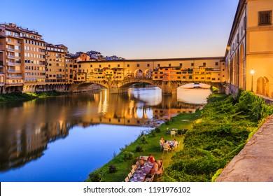 Florence, Italy. Ponte Vecchio bridge over Arno river at twilight.