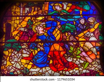 FLORENCE, ITALY -  SEPEMBER 25, 2018 Annuciation Mary Angel Gabriel Stained Glass Window Orsanmichele Church Florence Italy. Church and stained glass from 1400s. Angel tells Mary about Jesus.
