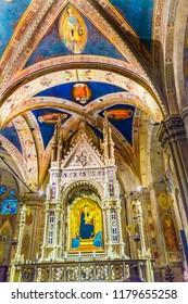 FLORENCE, ITALY -  SEPEMBER 25, 2018 Daddi Madonna Child Painting Orsanmichele Church Florence Italy.  Bernardo Dadi Painting 1365