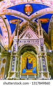 FLORENCE, ITALY - SEPEMBER 5, 2017 Daddi Madonna Child Painting Orsanmichele Church Florence Italy.  Bernardo Dadi Painting 1365