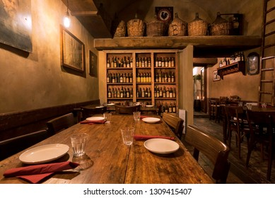 FLORENCE, ITALY - SEPT 24: Evening in bar with wooden tables, wine cellar and retro decoration of old italian restaurant on September 24, 2018. Historical Florence is a UNESCO World Heritage Site.
