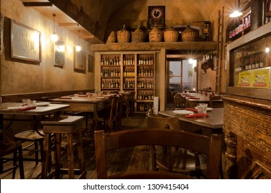 FLORENCE, ITALY - SEPT 24: Wine bottles and wooden vintage furniture inside traditional italian restaurant on September 24, 2018. Historical Florence is a UNESCO World Heritage Site.