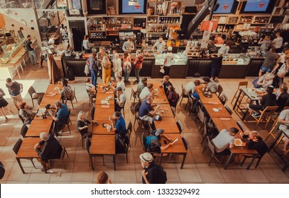 FLORENCE, ITALY - SEPT 25: Huge space with hungry people drinking and eating, inside central market fast food court on September 25, 2018. Near 87 percent of Florence population are Italian