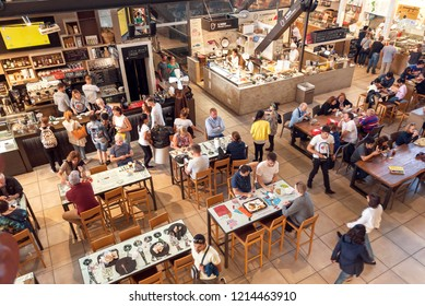 FLORENCE, ITALY - SEPT 25: Many tables at food court inside Mercato Centrale city market with tourists and locals on September 25, 2018. Near 87 percent of Florence population are Italian