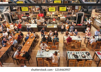FLORENCE, ITALY - SEPT 25: People having breakfast at popular food court inside Mercato Centrale city market on September 25, 2018. Near 87 percent of Florence population are Italian