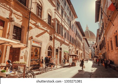 FLORENCE, ITALY - SEPT 26: Busy street life in center of the ancient Tuscany city with Cathedral and old houses on September 26, 2018. Historical Florence is a UNESCO World Heritage Site.