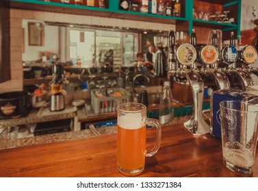 FLORENCE, ITALY - SEPT 26: Mug of fresh tap beer on bar counter of cafe at lunch time on September 26, 2018. Near 87 percent of Florence population are Italian