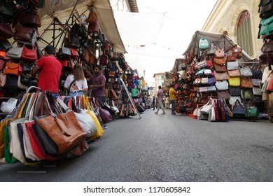 FLORENCE, ITALY - SEPTEMBER 1 2018 - People buying at old city leather market traditional shops that give food artisans centre stage.
