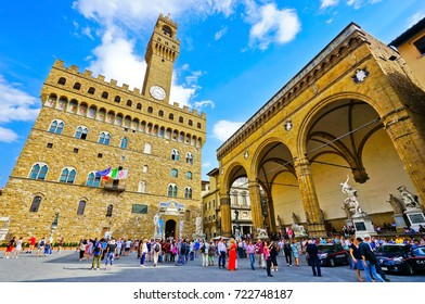 Florence, Italy - September 10, 2016 : View of the Palazzo Vecchio on the Piazza della Signoria with lots of visitors in Florence on September 10, 2016.
