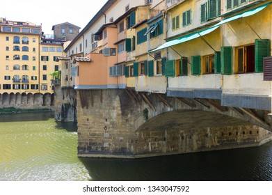 FLORENCE, ITALY - SEPTEMBER 14 2013 - Ponte Vecchio view with Arno river in the City of Florence, Italy