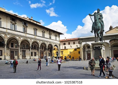 FLORENCE, ITALY - SEPTEMBER 17, 2017: Piazza della Santissima Annunziata; a busy paved square nearby famous Florentine museums and art galleries in San Marco district in Florence.