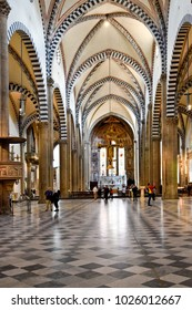 FLORENCE, ITALY - SEPTEMBER 19, 2017:  Interior of Santa Maria Novella; Tourists admire the interior of Santa Maria Novella; the first great basilica in Florence and Dominican church.