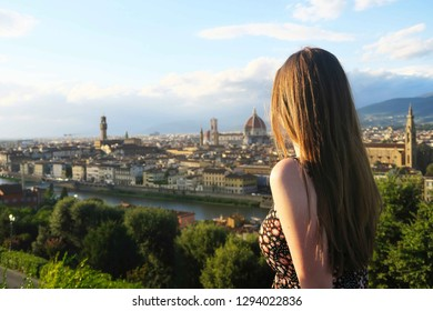 Florence, Italy - September 2017: Piazzale Michelangelo, Michelangelo Square, panoramic view of Florence, Italy with girl looking into distance