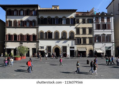 Florence, Italy - September 23, 2017: People walk on the Piazza San Lorenzo past historical buildings in Florence, Italy on September 23, 2017