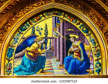 FLORENCE, ITALY - SEPTEMBER 24, 2017 Virgin Mary Angel Gabriel Annunciation Mosaic Duomo Facade Cathedral Church Florence Italy. Mosaic and church created in 1400s. Gabriel tells Mary about Jesus.