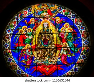 FLORENCE, ITALY - SEPTEMBER 25, 2017 Rose Window Virgin Mary Angels by Lorenzo Ghiberti 1405 Stained Glass Duomo Cathedral Church Florence Italy.