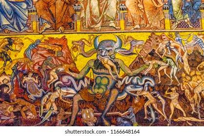 FLORENCE, ITALY - SEPTEMBER 25, 2017 Devil Satan Eating Evil Sinners Mosaic Dome Bapistry Saint John Duomo Cathedral Florence Italy. Bapistry created 1050 to 1150, mosaics by Friar Jacobus in 1200s.