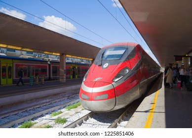 FLORENCE, ITALY - SEPTEMBER 25, 2017: The high-speed passenger train Frecciarossa ETR.1000 of the Trenitaliya company has arrived to the central railway station