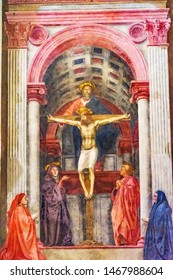 FLORENCE, ITALY  - SEPTEMBER 27, 2017 Masaccio Fresco Trinity Christ Santa Maria Novella Church Florence Italy. Created 1427 pioneering perspective in painting
