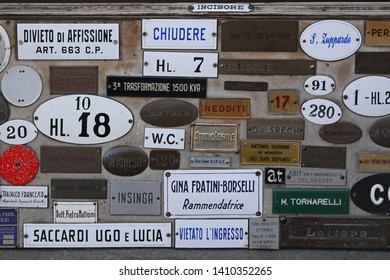 Florence, Italy - September 29, 2009: Old Style Door Signs and Name Plates in Firenze, Italy.