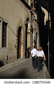 Florence, Italy - September 29, 2017: Female police officers walk in a historical street in Florence, Italy on September 29, 2017