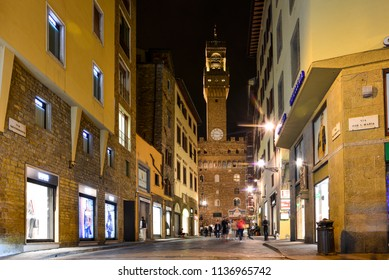 Florence / Italy — September 30, 2016: a street in the center of Florence in the evening with Palazzo Vecchio in the background