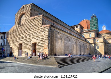 Florence, Italy - September 30, 2017: People sitting on the steps of the Basilica di San Lorenzo church in Florence, Italy on September 30, 2017